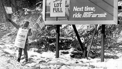 Flying the colors PAT driver Cindy Hoston of West Mifflin displays the colors to passersby on Lebanon Road in 1992.