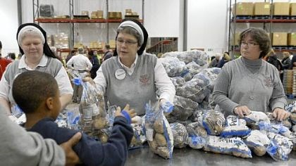 Food bank 1 From left, Sister Mary Anne Ulrich, Sister Donna Smith and Sister Christina Marie Janusek help at the Greater Pittsburgh Community Food Bank in Duquesne.