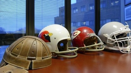 Change in football helmets Over the years, football helmets have grown in size and weight, as this array in neurosurgeon Julian Bailes' office in Evanston, Ill., shows. The leather helmet at far left was adopted to help prevent skull fractures. The modern-day helmet at far right does little to prevent concussions but is a fearsome weapon on the field.