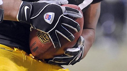 Forcing a fumble James Harrison comes away with the football after forcing a fumble against Cowboys quarterback Tony Romo yesterday at Heinz Field.
