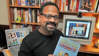 "Francis Cleetus Francis Cleetus with his ""It's Geek 2 Me"" toons."