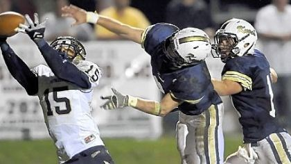 Franklin receiver Franklin Regional's Charan Singh pulls in a pass for a touchdown as Knoch's Ben Tackett and Dakota Bruggeman defend during a game played Oct. 4.