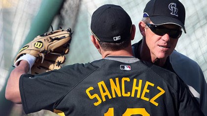 Freddy Sanchez and Jim Tracy Pirates second baseman Freddy Sanchez, hugs Rockies manager and former Pirates manager Jim Tracy before last night's game.
