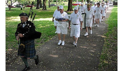 Frick Park Lawn Bowling Club Dressed in their playing whites, members of the Frick Park Lawn Bowling Club parade behind bagpiper George Balderose to the dedication of the recently renovated club house May 28.