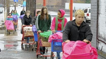 Full of good Braving Sunday morning's pouring rain, young people from the Allegheny Unitarian Universalist Church push carts containing 100 bags of groceries to the Northside Common Ministries Food Pantry on Brighton Road.