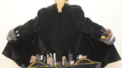 Fur coat A fur coat with the Pittsburgh skyline on the back and the two stadiums on the sleeves for sale at Carl W. Herrmann Furs.