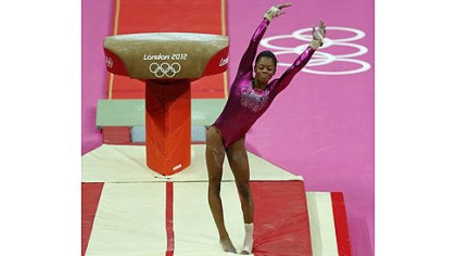 gabby douglas olympics U.S. gymnast Gabrielle Douglas dismounts from the vault during the Artistic Gymnastic women's individual all-around competition today.