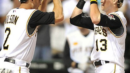 Game-winning celebration Pirates Nate McLouth is greeted at home by Jack Wilson after hitting a game-winning two run homer against the Yankees in the 7th inning at PNC Park last night.