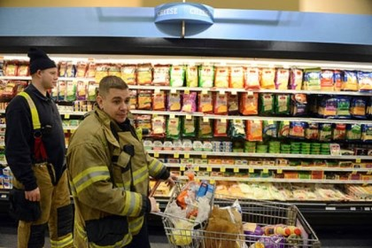 gardell and reiser giant eage Lt. John Gardell, center, and firefighter Dan Reiser, return to Giant Eagle to find their cart exactly where they left it on Friday, Jan. 18, 2013.