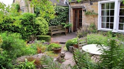 Garden designer A view of the rear garden of Mary and Gordon Hayward at their cottage in Cotswold Hills, England.