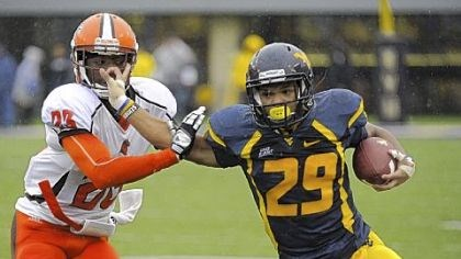 Garrison West Virginia's Dustin Garrison, right, fends off Bowling Green's Aaron Foster. Garrison finished the Mountaineers' 55-10 victory in Morgantown, W.Va., with 291 yards rushing.