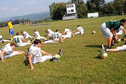 Geibel3 The Geibel Catholic High School football team stretches before a practice in Connellsville, Fayette County. The team prac
