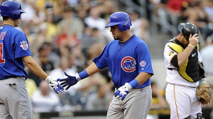 Geovany Soto, Tyler Colvin and Mike McKenry The Cubs' Geovany Soto, center, is congratulated by teammate Tyler Colvin after hitting a home run against the Pirates in the third inning of Thursday's game at PNC Park. Pirates catcher Mike McKenry adjusts his helmet.