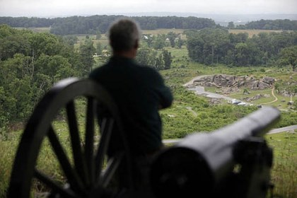 gettysburg cannon A visitor to Little Round Top takes in the view of Devil's Den this morning.