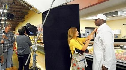 giant eagle ads Andre Rodgers, right, prepares for a take while shooting a Giant Eagle commercial in the Pine store.
