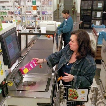 gianteagle1 Jane Bircher of Highland Park checks out her groceries at a self-checkout at the Giant Eagle at the Waterworks Mall.