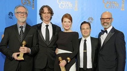 "Globes winner ""Game Change"" ""Game Change"" producer Gary Goetzman, left, director Jay Roach, actress Julianne Moore, writer Danny Strong and producer Steve Shareshian celebrate Golden Globe wins for best miniseries or motion picture made for television and best actress, miniseries or TV movie for Ms. Moore. Ed Harris also won for supporting actor, miniseries or TV movie."