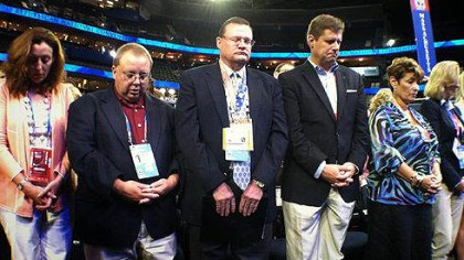 GOP convention 1 The Republican National Convention in Tampa opened with prayer. These are members of the Massachusetts delegation.