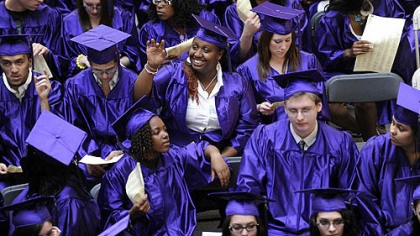 Graduates Octavia Shelly, 20, from West Mifflin High School, waves to onlookers before the graduation ceremony for the class of 2010 from Phase 4 Learning Center at the Century III Mall in West Mifflin on May 26.