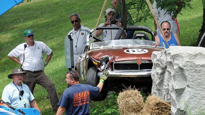 Grand Prix crash Crews remove Philip Cooper's 1974 MGB after it crashed into a stone monument along East Circuit Drive during the MG Marque Race, part of the 30th annual Vintage Grand Prix in Schenley Park. Mr. Cooper was not injured.