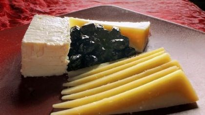 Greek Cheese Cheeses from Greece, clockwise from left: Feta, kefalotiri and graviera with oil-cured olives, all from Salonika Imports in Lawrenceville.