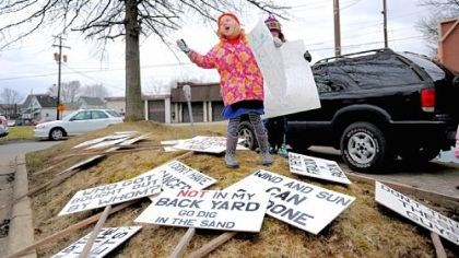 Gretta Boerner Gretta Boerner, 6, of New Wilmington, asks protesters gathered to pick up signs during the Rex Energy protest.