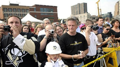 Groundbreaking Justin Hackman, 8, of Baldwin, anticipates a loud noise yesterday during groundbreaking for the new Penguins arena.