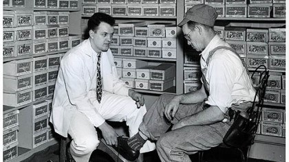 H.J. Heinz Co. in-house shoe store The growth of factory work created blue-collar and white-collar workforces, often in the same setting. Here, a salesman in the H.J. Heinz Co. in-house shoe store helps a worker there try on a pair of shoes in 1949.