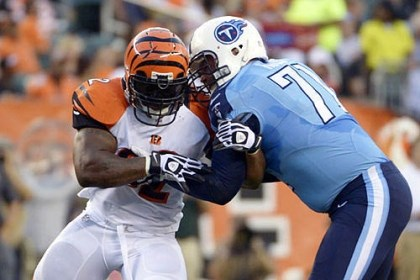 harrison with the bengals In this Aug. 17 photo, Cincinnati Bengals outside linebacker James Harrison, left, pushes against Tennessee Titans tackle Michael Roos in the first half of a preseason game.