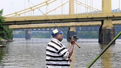 Harry Blackwell and a bridge Harry Blackwell prepares to fish the Allegheny River Friday from a spot on the North Shore underneath the Clemente Bridge.