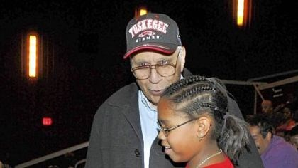 "Harry Lanauze Harry Lanauze, 85, greets and encourages 11-year-old Lyndsey Thompson of Mount Washington before the opening of the movie ""Red Tails"" at the AMC-Loews Waterworks theater. Dr. Lanauze was a pilot with the Tuskegee Airmen."