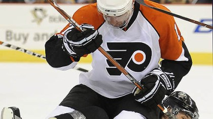 Have a seat Evgeni Malkin is taken down by the Flyers' Jeff Carter in the first period.