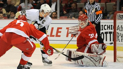 He scores! Sidney Crosby beats Detroit goalie Chris Osgood for a goal Tuesday night at Joe Louis Arena.