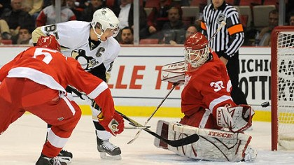 He scores! Penguins' Sidney Crosby scores against Redwings goalie Chris Osgood tonight at the Joe Louis Arena, Detroit.
