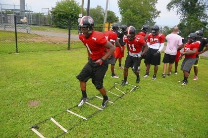 heat Running back Dravon Henry goes through a drill during an Aliquippa football practice.