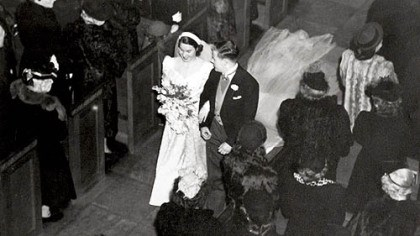 Heinz Chapel's first bride Jean Eddy Succop and John C. Succop walk down the aisle of Heinz Chapel after being the first couple to marry there in 1946. Their daughter, Elizabeth Altman, was married there in 1976 and their granddaughter, Sarah Altman, will be married there today.
