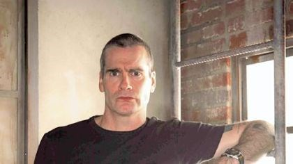 Henry Rollins photo Henry Rollins is sought more for his brain than his brawn these days.