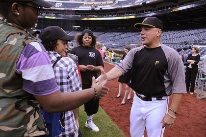 "Herbie Andrade Pirates player Herbie Andrade greats Hezekiah Moore, 17, of Homewood, who is one of the seven members of the YMCA's Lighthouse Project at Westinghouse High School, on a tour of PNC Park as Pirates Charities and player Andrew McCutchen help the group fund its trip to perform their song ""All In"" at the YMCA Global teen Leadership Conference in Prague, Czech Republic."