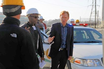 Hill District native James Wilcox with CSI Miami star David Caruso. Hill District native James Wilcox with CSI Miami star David Caruso.