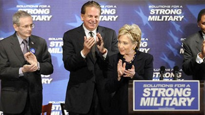 Hillary Rodham Clinton On stage with, from left, retired Gen. Michael Dunn, retired Adm. David Stone and retired Gen. John Watkins, Sen. Hillary Rodham Clinton applauds the crowd at Hopewell High School yesterday.