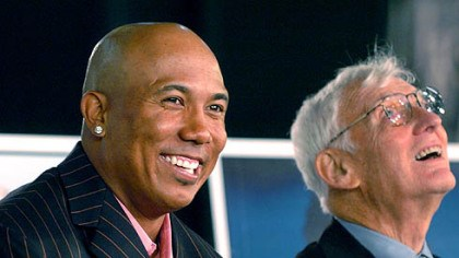 Hines Ward and Dan Rooney The Steelers' Hines Ward smiles to the audience while being introduced as a member of the Steelers All-Time Team. At right is team chairman Dan Rooney.