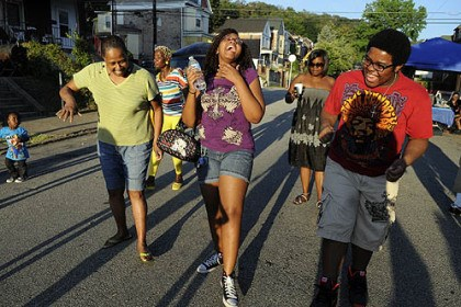 Homewood 1 All ages joined in to dance at the National Night Out event Tuesday on Monticello Street in Homewood, including (from left) Gwen Jackson, Brooklynne Price, 17, and Craig Pack, 17, all of Homewood.