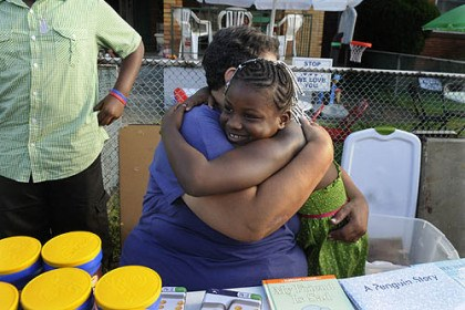 Homewood 2 Danise Page of Homewood, hugs Cierra Price-Knight granddaughter of Lawanda Long, one of the organizers of the Monticello Street events at the National Night Out in Homewood.