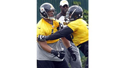 Hood Ziggy Hood, right, works against fellow defensive end Al Woods in an OTA last month.