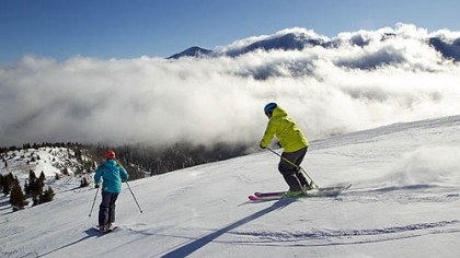 Hope for the slopes? Colorado's resorts and hotels are hoping that snowboarders and skiers, such as those in this Jan. 26, 2012 file photo, will burn off some pent-up demand for deep snow this winter.