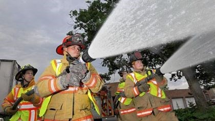 Hoses From left, Clairton volunteer firefighters Phil Marra, Jesse Dinkel, William Smoyer and Jesse Fruciano demonstrate using their fire hoses outside their station in Clairton.