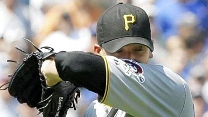 Hot pitch Pirates starting pitcher Charlie Morton wipes sweat from his face during the second inning of Friday's loss to the Cubs.