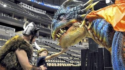 "How to Train Your Dragon Live Sig the Viking shows Caden Suba, 8, of Franklin Park to find the ""soft spot"" of baby dragon Nadder at the How to train your dragon Live Spectacular preview July 26 at Consol Energy Center."