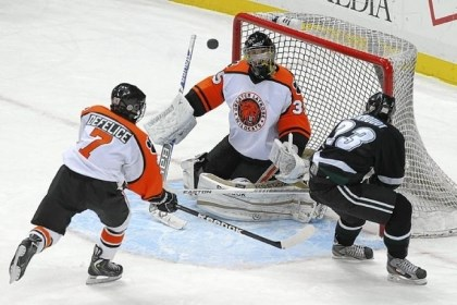 hsdoub Latrobe goalie Shane Brudnok blocks a shot by Pine-Richland's Drew Berkhoudt in the Class AA Penguins Cup game Wednesday night at Consol Energy Center.