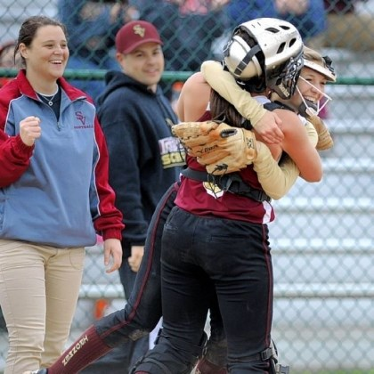 Hssoft2 Steel Valley pitcher, Maddie Cotter, right, and catcher Carley Rosso celebrate a first-round win.